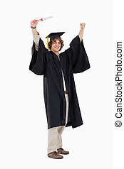 Male student in graduate robe raising his arms