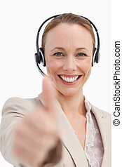 Portrait of a businesswoman with a headset approving
