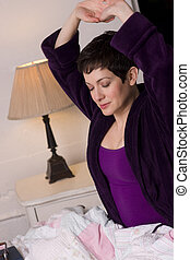 Sleepy Head - A pretty brunette woman in her robe just wakes...