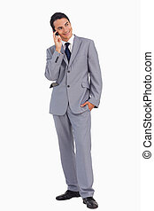 Man in a suit smiling while calling