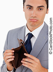 Portrait of a man in a suit with an empty wallet