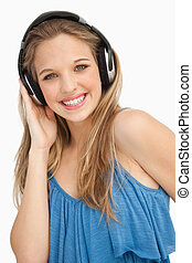 Portrait of a beautiful young woman wearing headphones