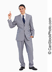 Smiling man in suit pointing up