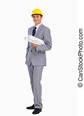 Man in a suit with safety helmet and plans