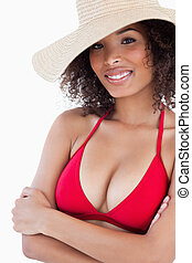 Smiling young woman wearing a straw hat