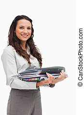 Portrait of a brunette carrying a lot of files
