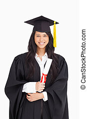 Woman with her degree dressed in her graduation gown - A...