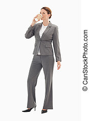 Businesswoman drinking coffee - A businesswoman is drinking...