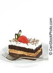 Piece of chocolate cake with strawberry decorate on top