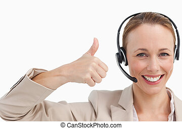 Woman in a suit with a headset the thumb-up