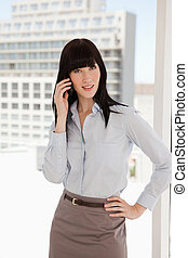 Business woman on the phone - A business woman at work...