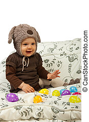 Baby playing with Easter egss - Happy baby with bunny cap...