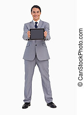 Man in a suit showing a tactile tablet screen