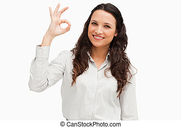 Portrait of a brunette approving with hand