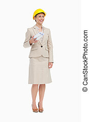 Woman in a suit wearing a safety helmet