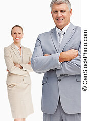 Cheerful business people with folded arms