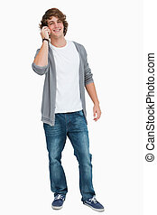 Male student smiling on the phone