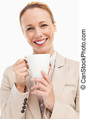 Portrait of a woman in a suit holding a mug