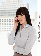 A woman in a suit receiving a phone call - A business woman...