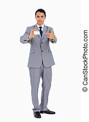 Good-looking man showing and pointing his business card...