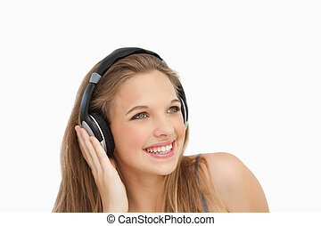 Close-up of a smiling student wearing headphones