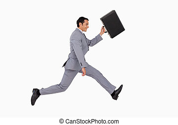 Businessman running with a suitcase against white background