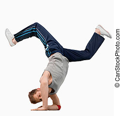 Break dancer doing a hand stand against a white background
