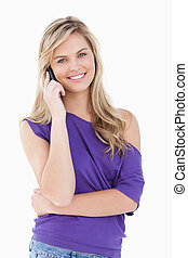 Happy blonde woman using her cellphone
