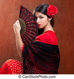 Gipsy flamenco dancer Spain girl with red rose and spanish...
