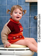 Child on the toilet - Little girl on the toilet that makes...
