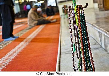 Men praying in Ulucami, Bursa, Turkey