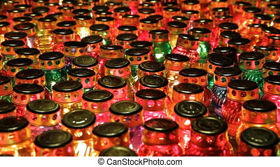 Many glass candles - Many glass lamps with lights from...