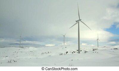Windmills in winter landscape