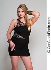 Blonde - Pretty young plus size blonde in a black dress
