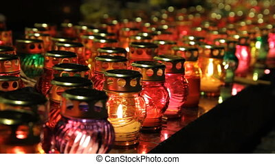 glass candles - Many glass lamps with lights from candles...