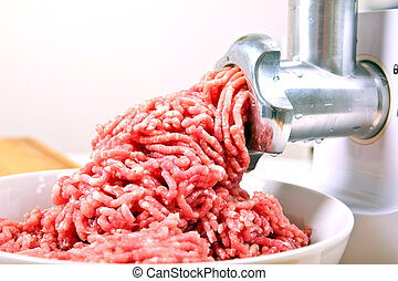 Making minced meat in the kitchen.