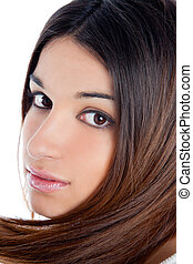 asian brunette indian woman with long hair closeup
