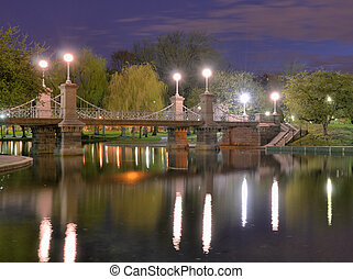 Boston Public Gardens - Lagoon Bridge and skyline of Boston,...