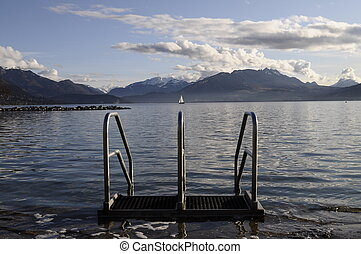 Annecy lake and metallic stairs to water