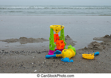 Childrens toys at the beach - Toys of a child at the beach...