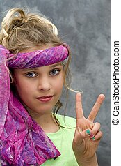 Preteen Gives Peace Sign - Pretty young girl giving peace...