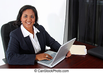 Business Woman - Woman in an office who is ready to work