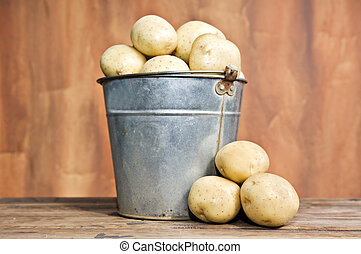 Bucket of fresh potatoes - Old bucket filled with potatoes...