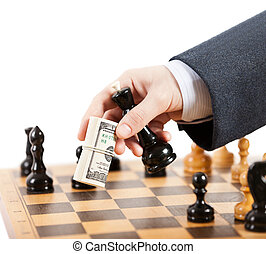 Businessman unfair playing chess game - Business man hand...
