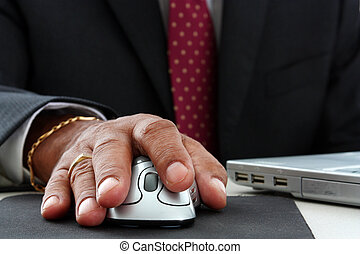 Minority Businessman - Minority businessman on his laptop...