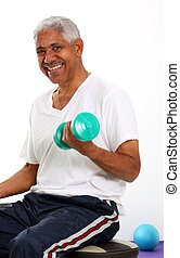 Senior Man Lifting Weights - Senior Minority Man Working Out...