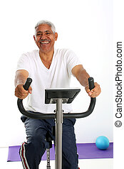 Senior Man Riding Bike - Senior Minority Man Working Out Set...