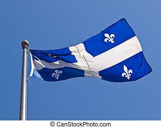 Quebec Flag Flying - Large flag of Quebec fluttering in the...