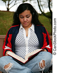 Teenager Studying Outside - Teenager with studying for a...