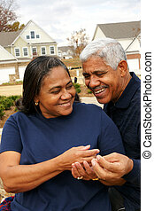 Senior Couple - Family together outside their home